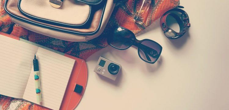 Sunglasses with a bag and notebook.