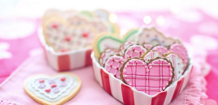 A table of wedding cookies, shaped like hearts.