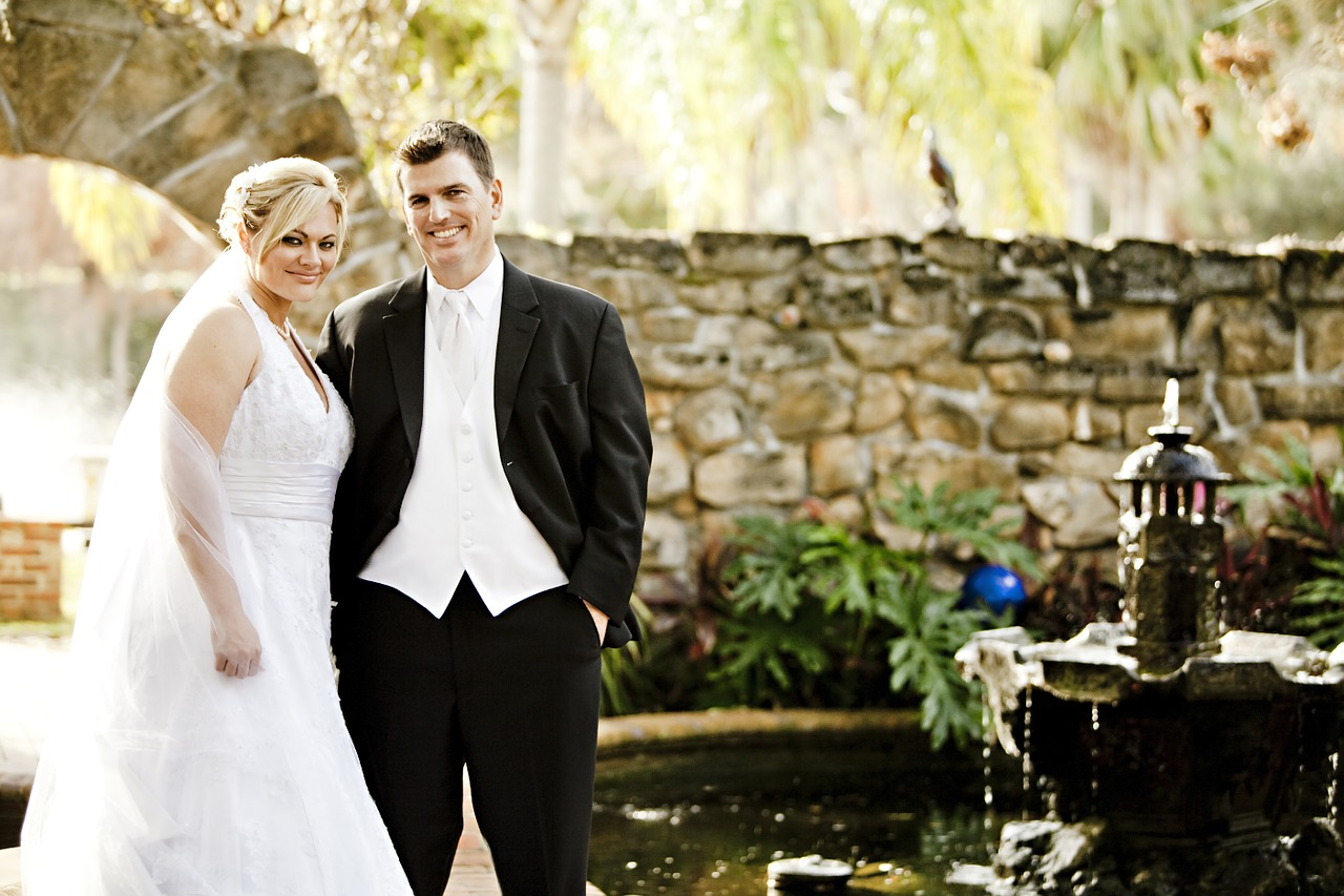 Bride and groom with bride wearing a halter style dress.