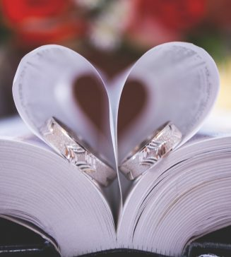 Wedding rings in the pages of a Bible.