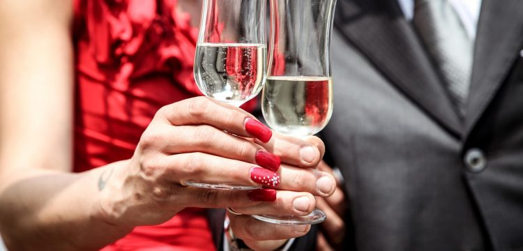 Couple with champagne glasses.