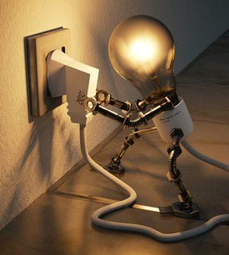 A light bulb inserting a plug to denote power.