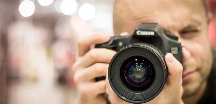 Photographer aiming his camera.