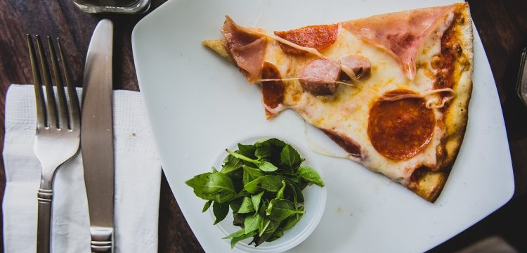 Pizza served on a nice plate.