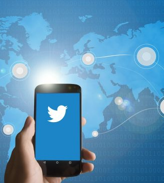 Twitter logo on a phone.