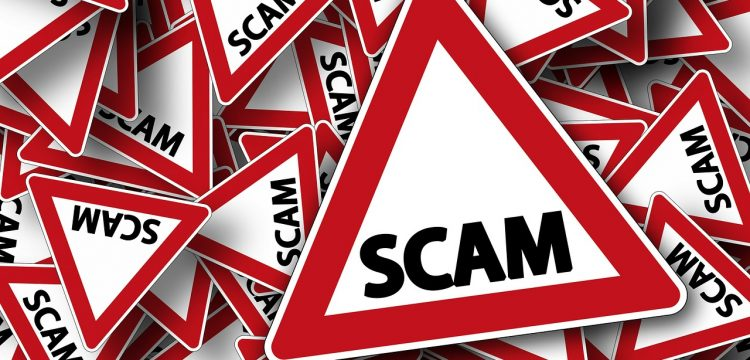 """Graphic that reads, """"scam""""."""