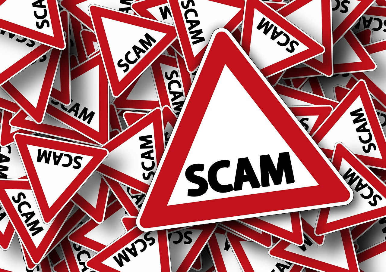 "Graphic that reads, ""scam""."