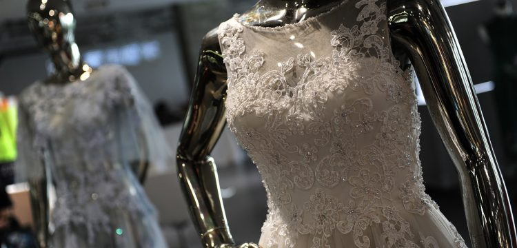 Wedding gowns on mannequins.