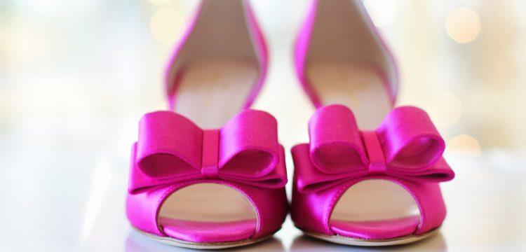 Bright pink bridal shoes.