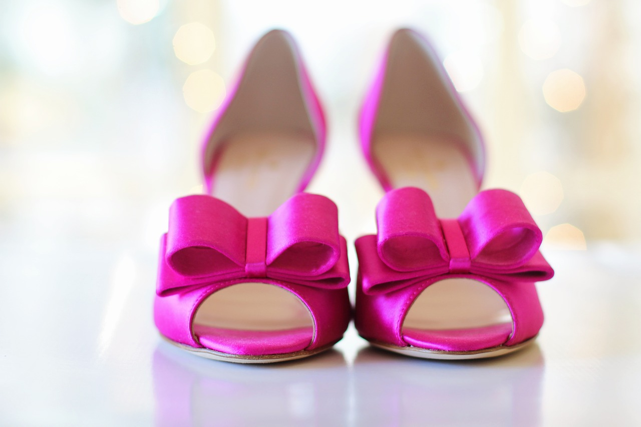 Bright pink bridal shoes.