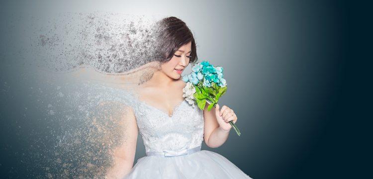 Model wearing a high fashion wedding dress.