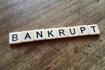 "Scrabble letters that spell ""bankrupt""."