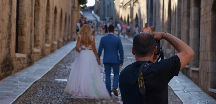 Photographer taking photo of bride and groom.
