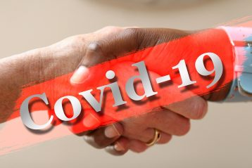 Graphic of Covid 19 with people shaking hands.