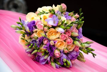 Brightly colored wedding bouquet.