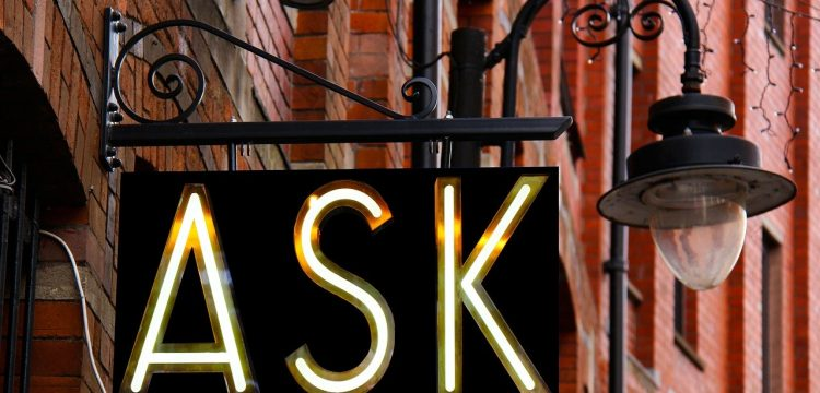 """A sign that reads, """"Ask""""."""