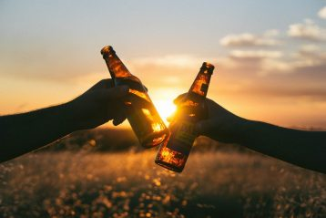 Couple toasting with beer.