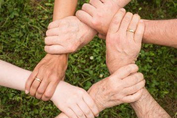Interlaced hands.
