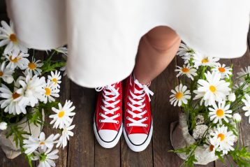 Bride wearing red sneakers.