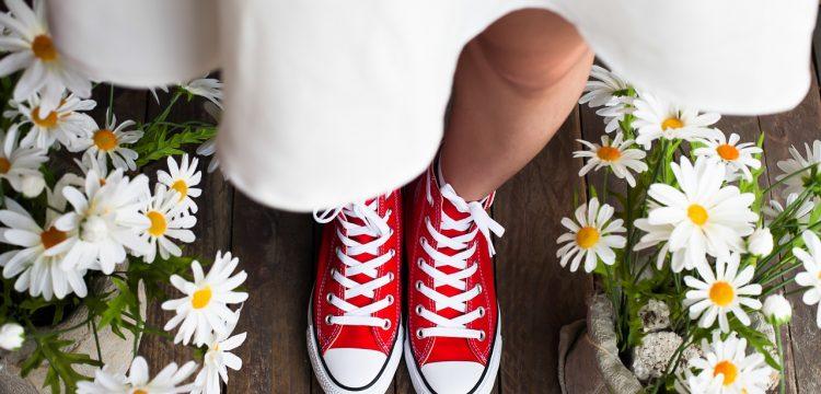 Bride wearing red sneakers.
