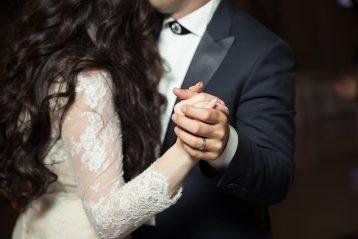 Bride and groom dancing.