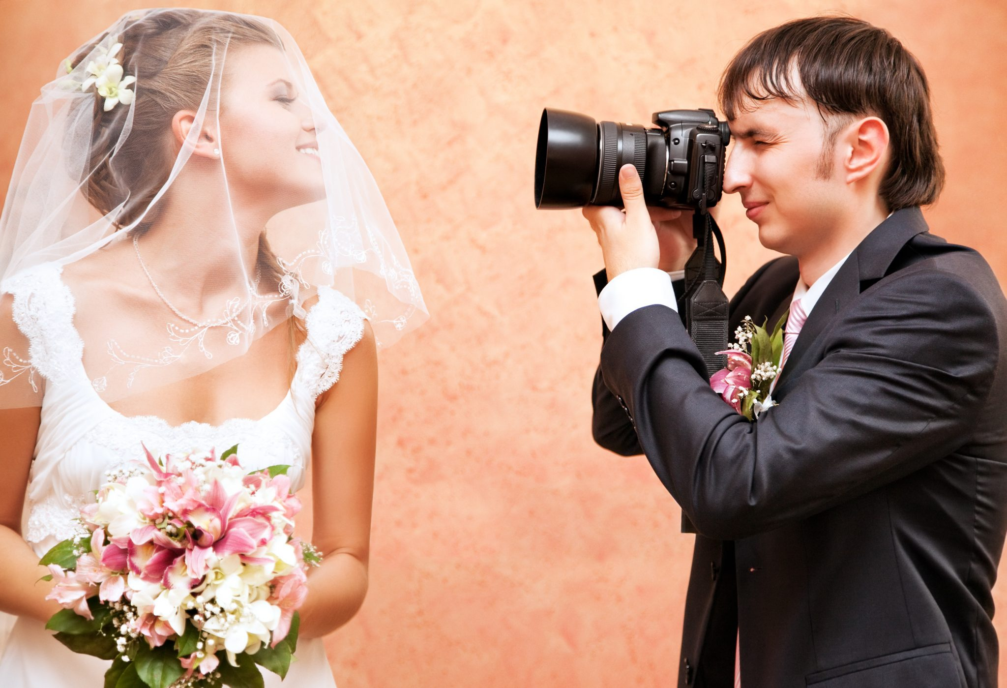 Man photographing a bride.
