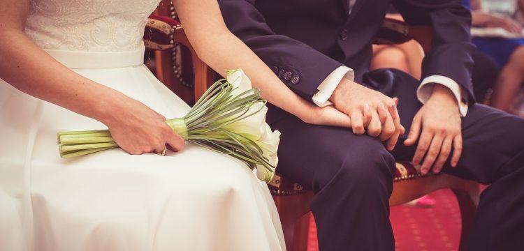 Bride and groom sitting.