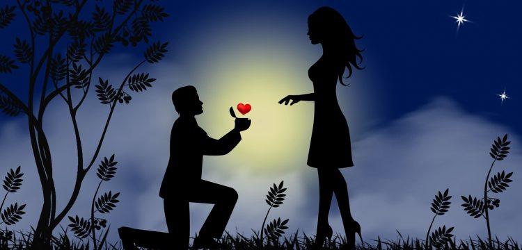 Man proposing to a woman.