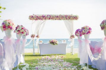 Wedding flowers at a ceremony site.