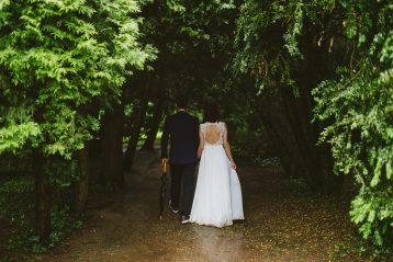 Bride and groom walking.