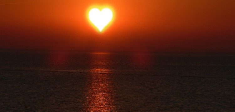 The sun in the shape of a heart.