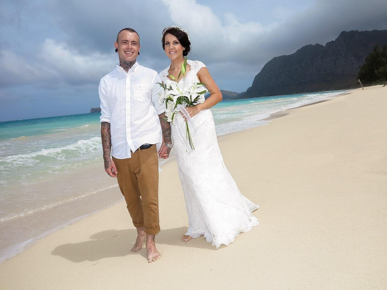 Bride and groom on a Hawaiian beach.