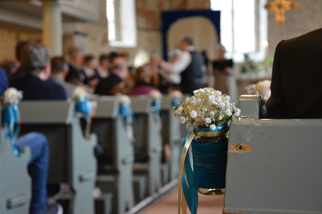 wedding guests in pews