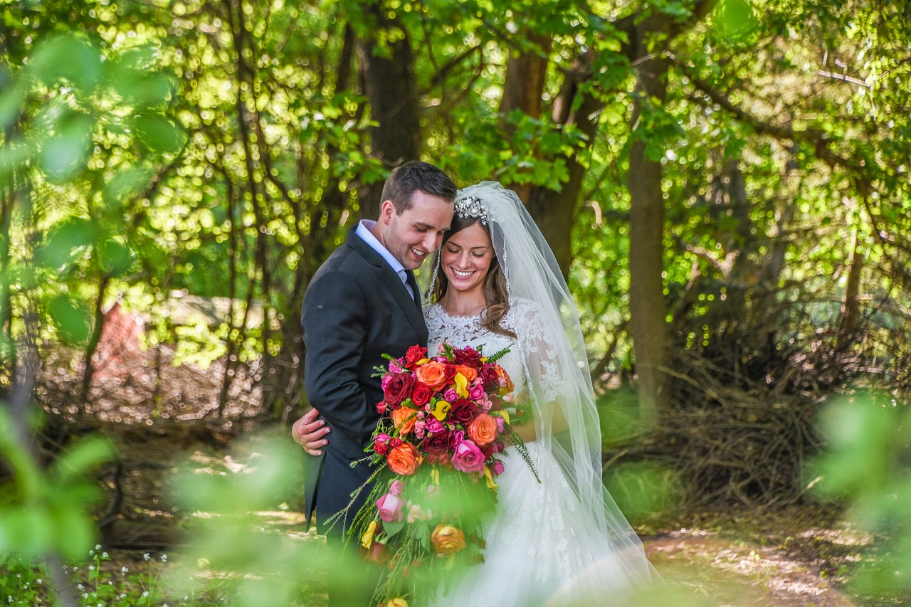 Bride and groom in the woods.