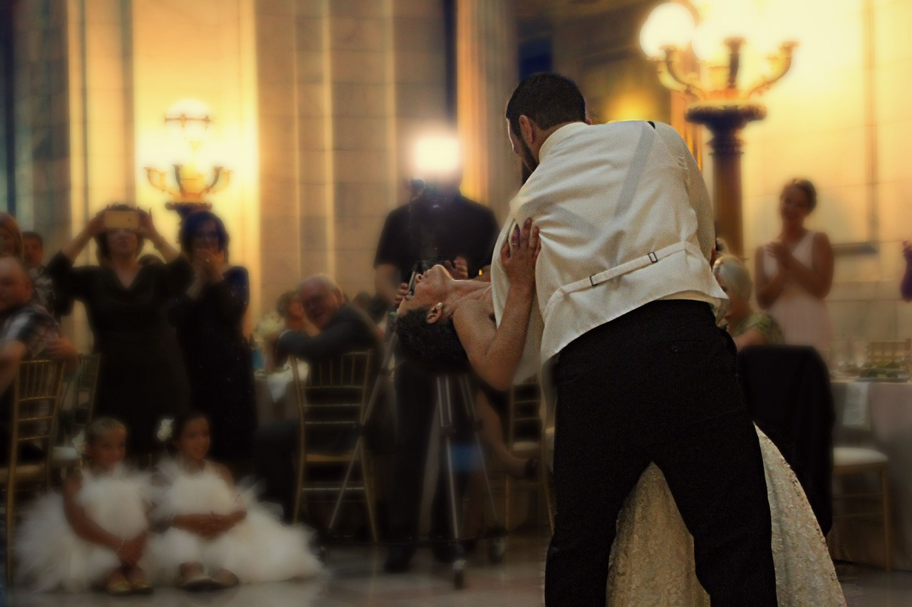 Bride and groom dancing.
