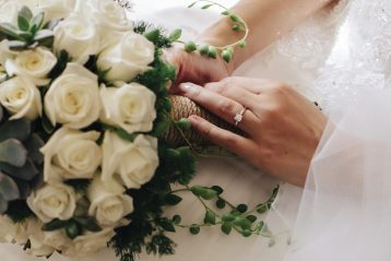 Bride wearing an engagement ring.