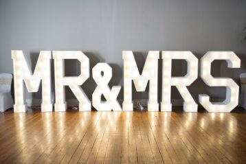 "Large lights that spell out ""Mr. and Mrs.""."