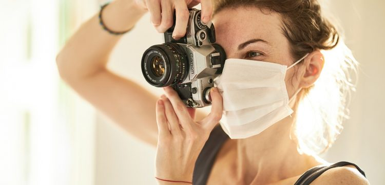 Person wearing a COVID mask and taking a picture.