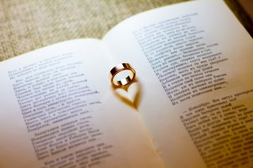Wedding ring and Bible.