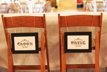Bride and groom's chairs at reception.
