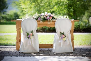 Wedding reception chairs at a table.