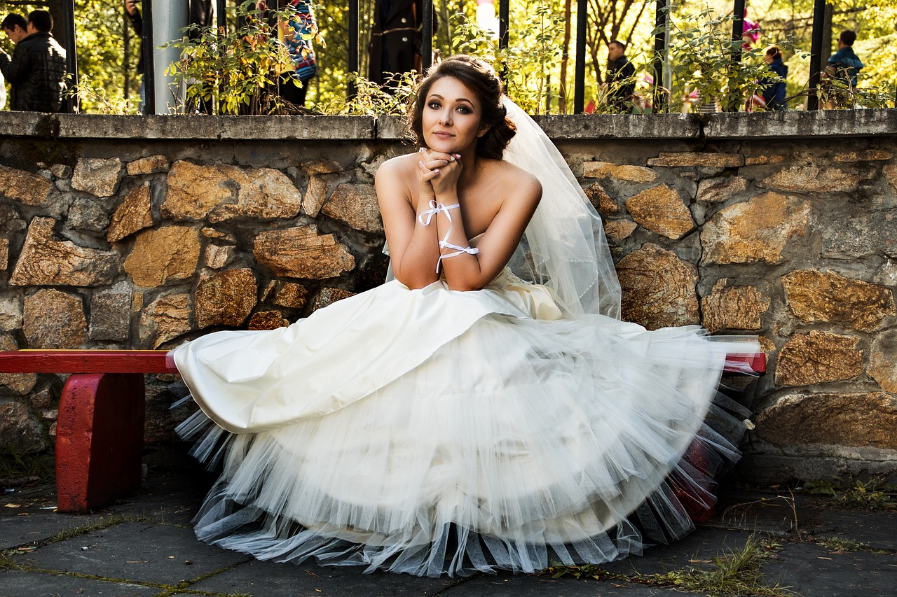 Bride sitting on a bench.