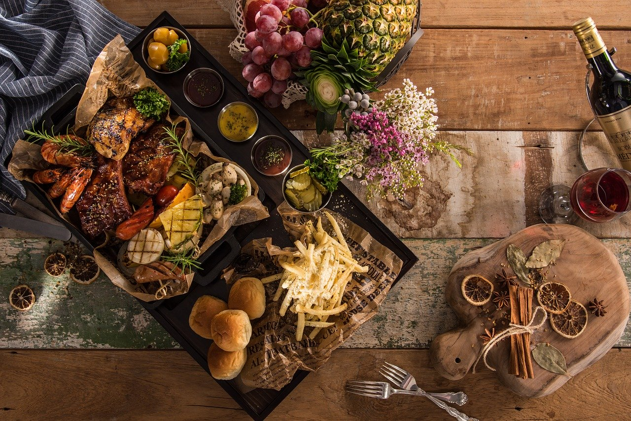 A catering table full of food and drink.