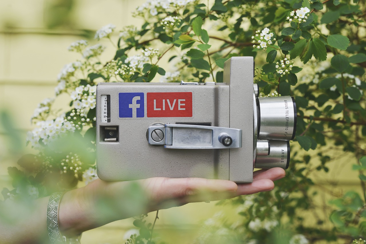 A camcorder with a Facebook Live sticker on it.