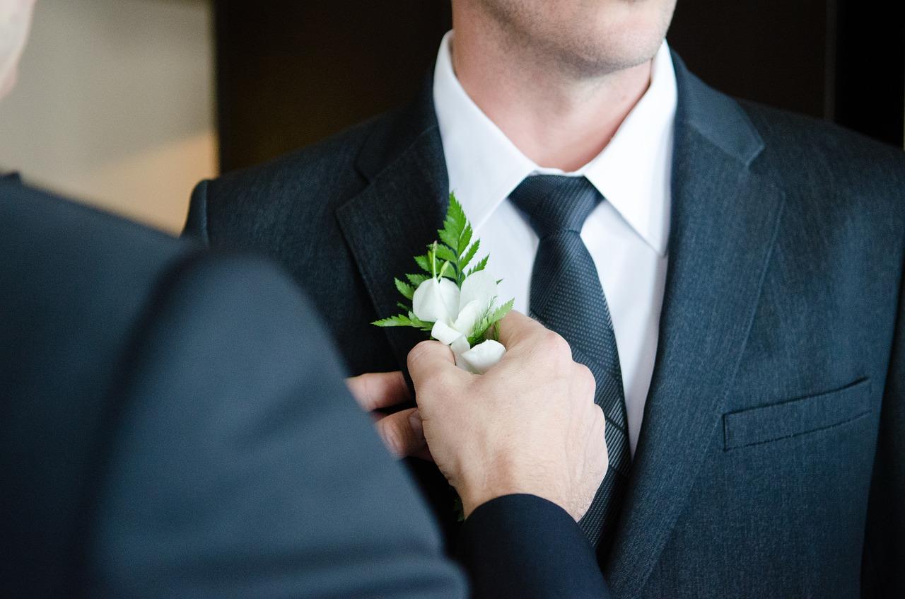 Groom wearing a suit.