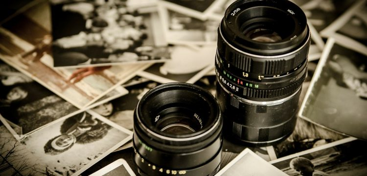 A picture of camera lenses and photographs.