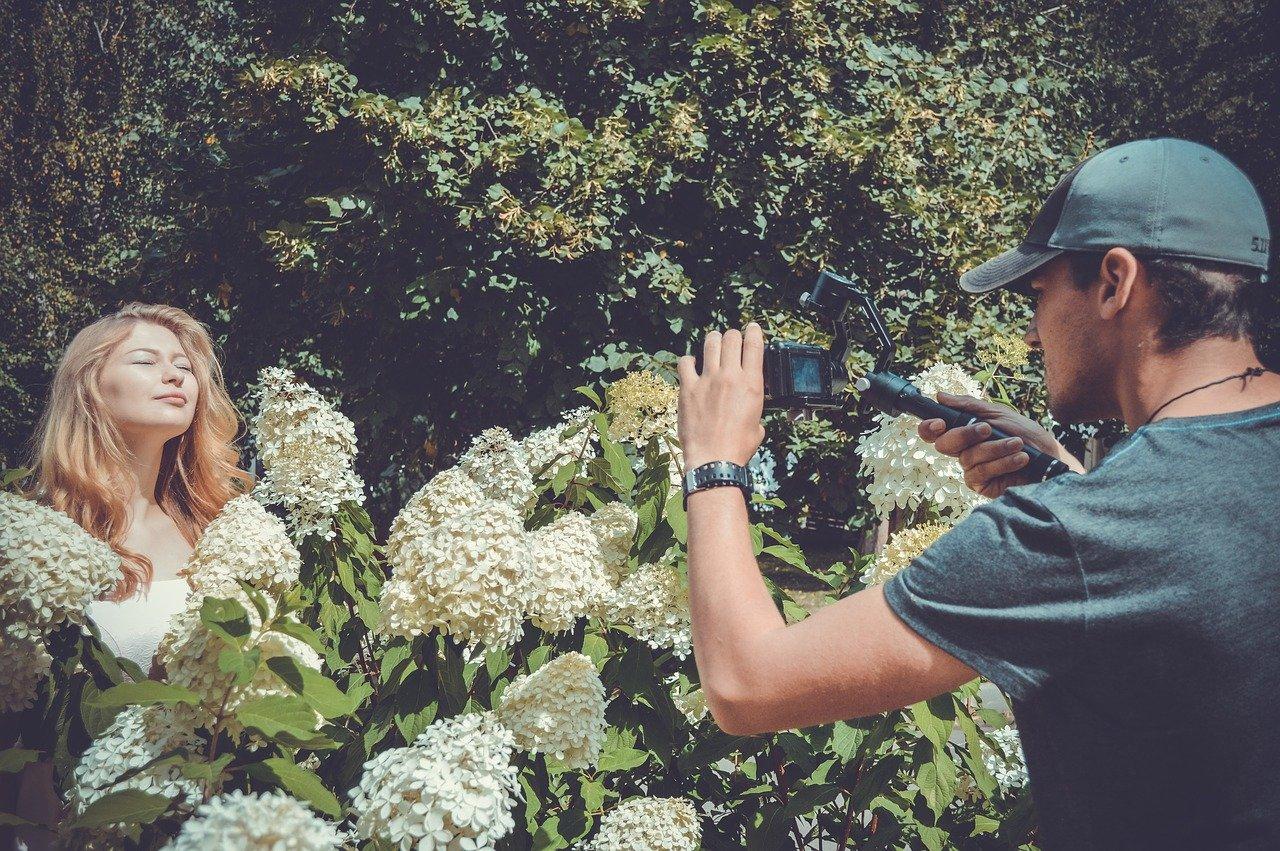 Videographer filming a bride.