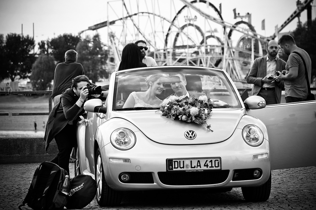 Photographer taking picture of bride and groom.