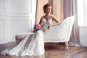 Bride sitting on sofa.