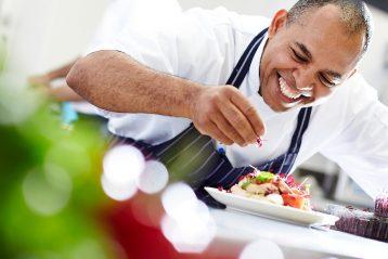 Chef/caterer preparing a dish.